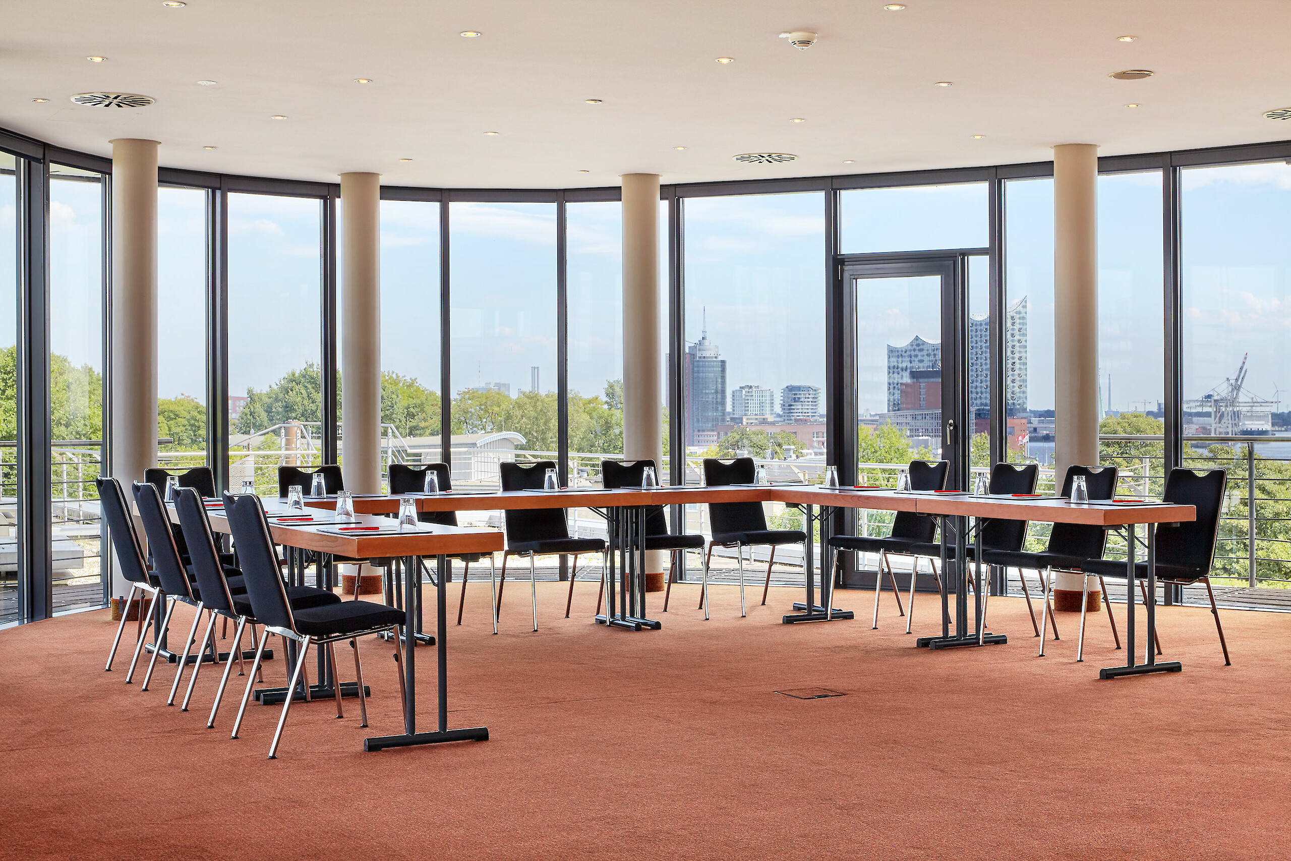 A prepared meeting room with a view of the Elbphilharmonie
