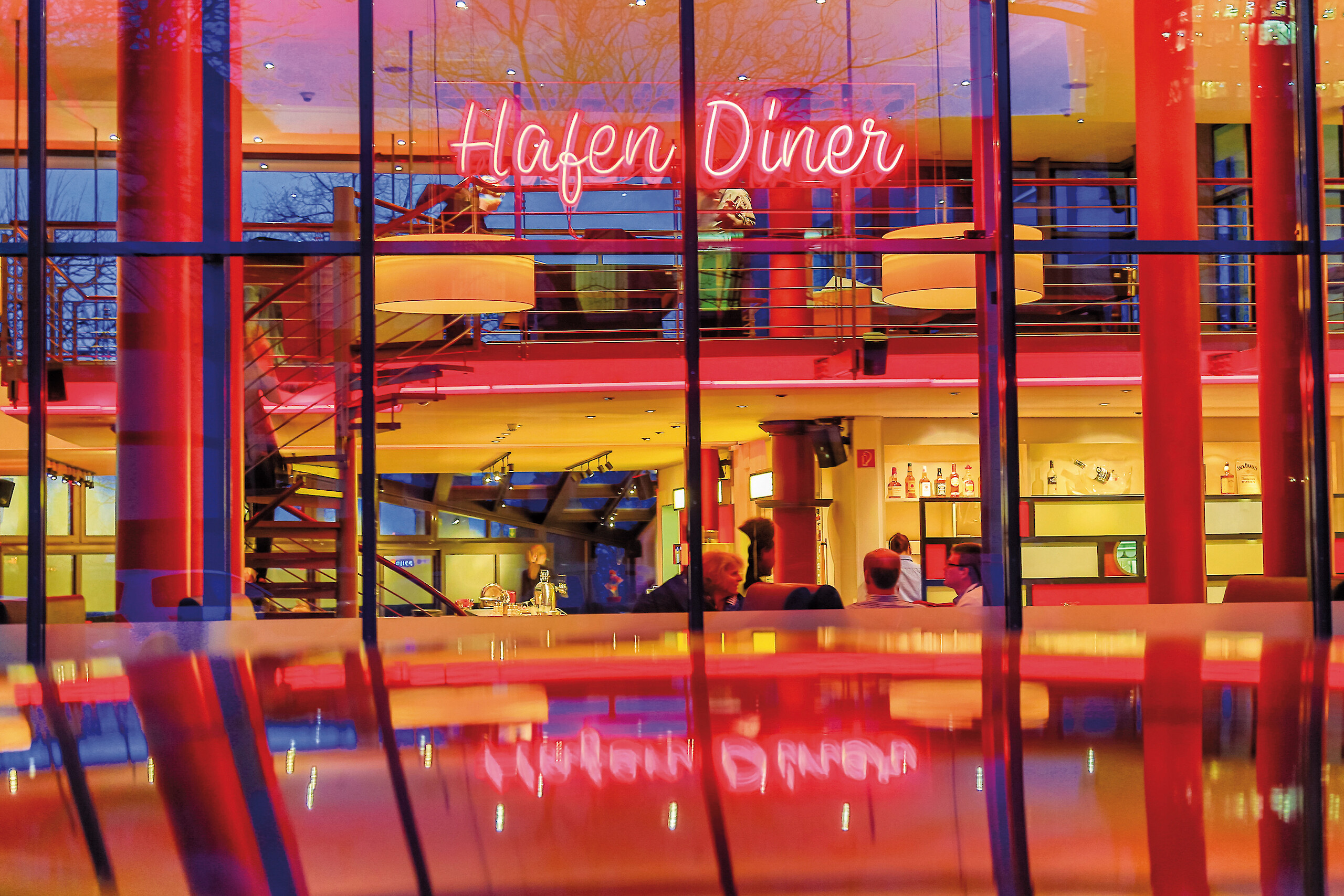 An exterior view of the Harbor Diner with a neon glowing sign